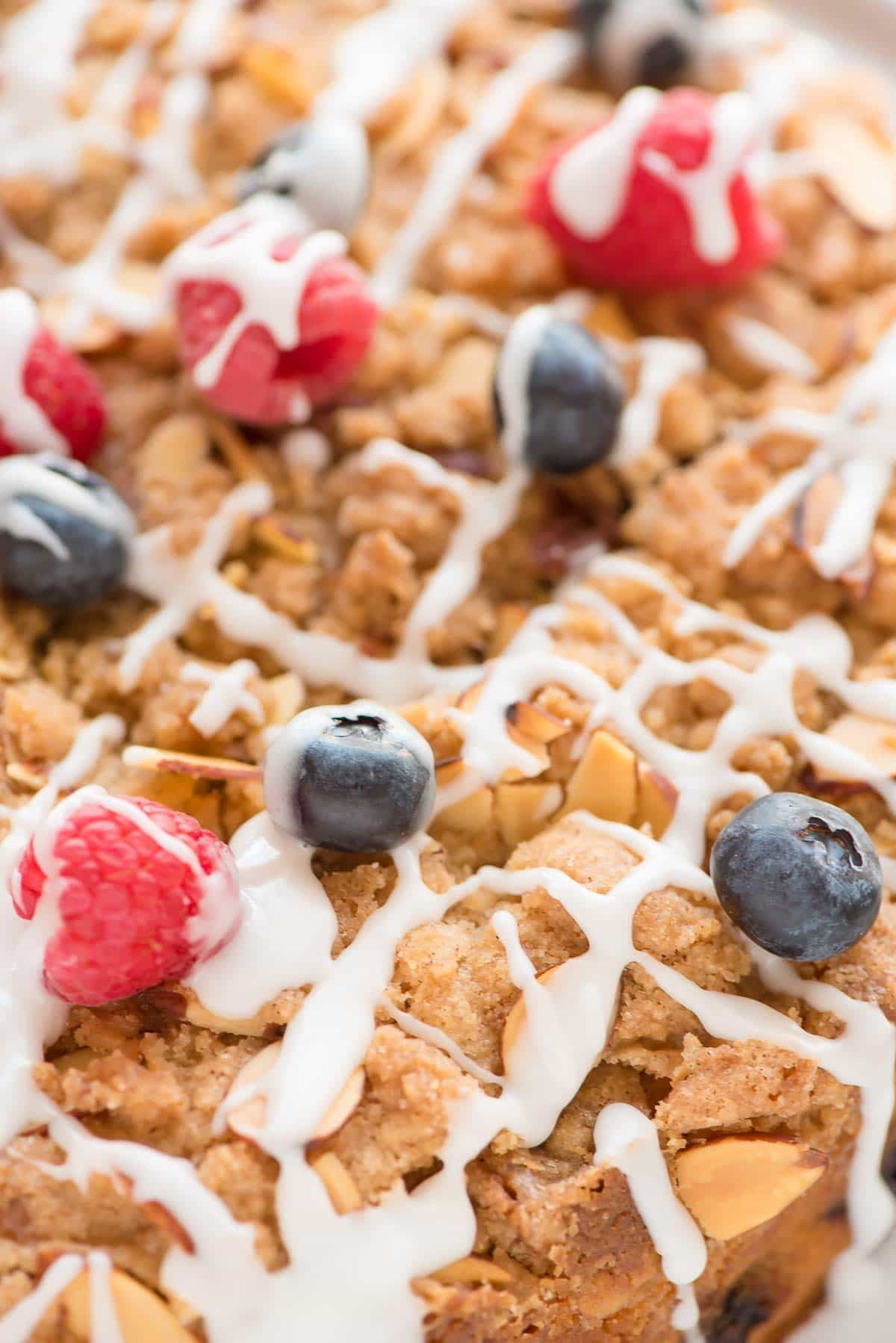 This Berry Crumb Cake recipe is perfect for brunch! It has TONS of buttery crumbs, the cake is so soft and moist, and you get a blueberry in every bite. @wellplated