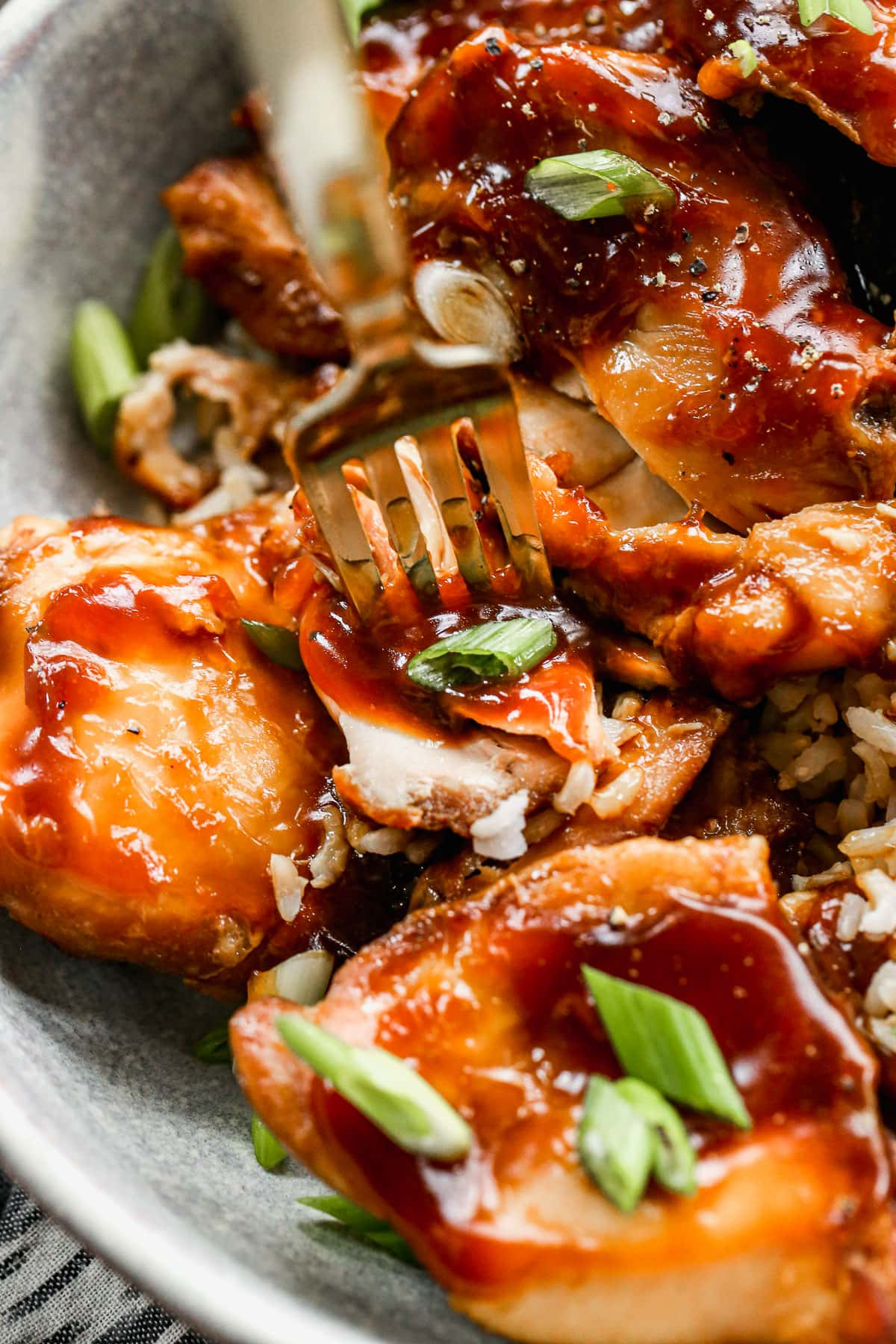 Crock Pot Bourbon Chicken — this tastes just like the Bourbon chicken at Chinese take out restaurants, but is made of simple, real ingredients. Sweet, smoky, and our whole family loves it! Serve with rice for an easy meal. @wellplated