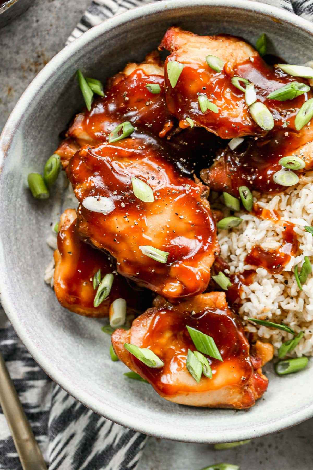 This Crock Pot Bourbon Chicken is the perfect slow cooker recipe! It's easy, delicious, and made with simple ingredients. The whole family loves it! @wellplated