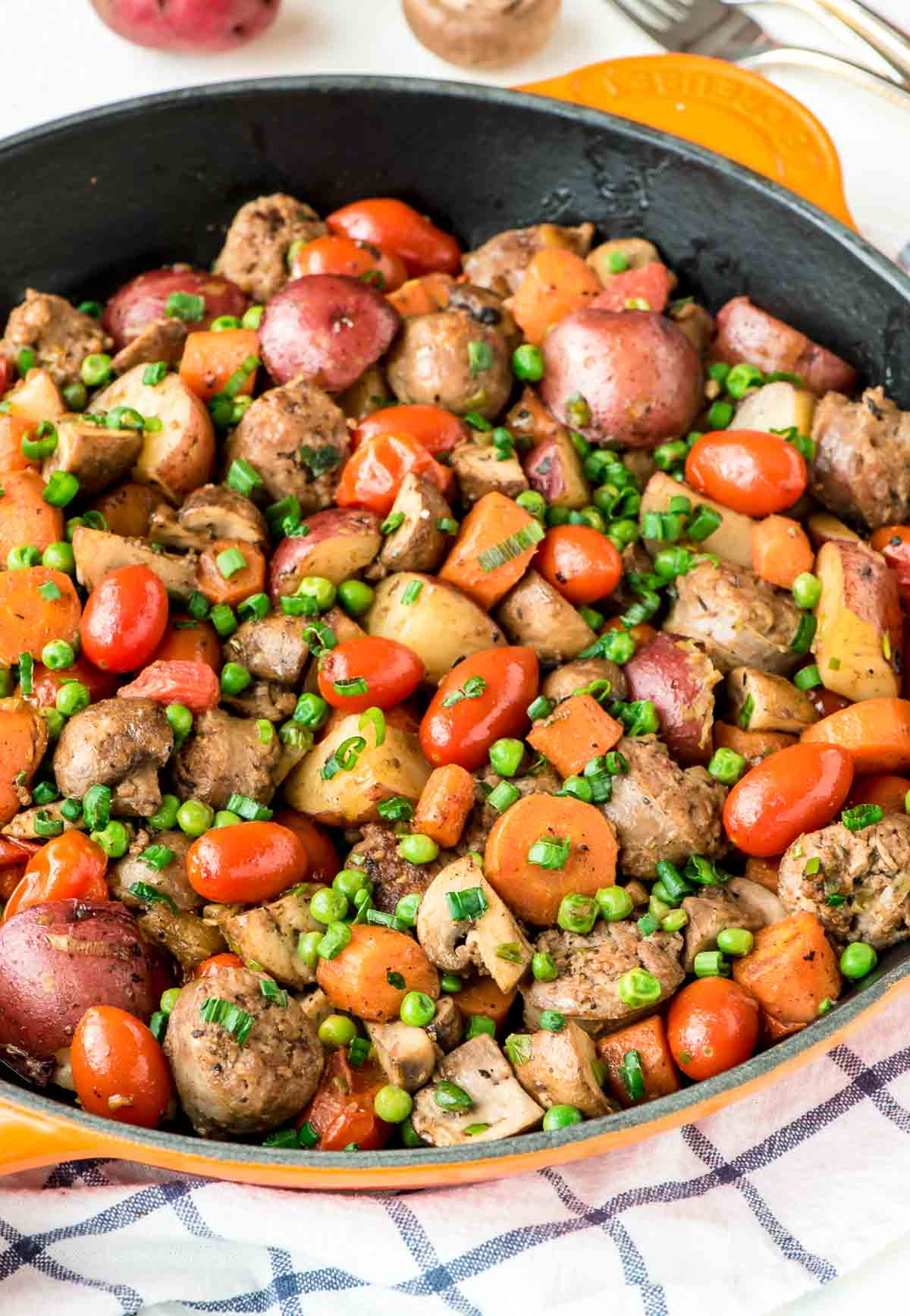 An easy On Pan Italian Sausage Skilled filled with fresh veggies, smoky sausage, and potatoes. Nutritious, filling, and you'll only have one pan to wash! Perfect for an easy dinner. @wellplated