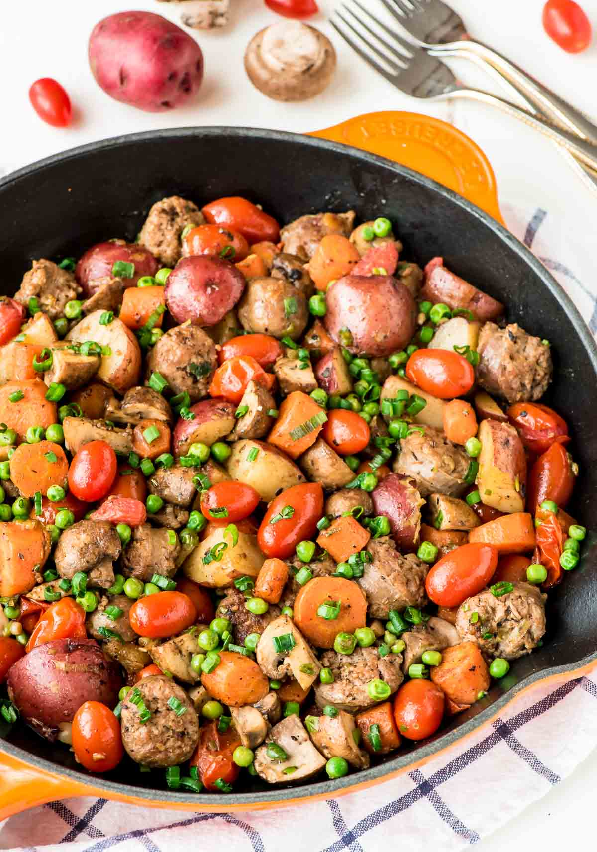 Italian Sausage Skillet. An easy, healthy one-pan dinner! Packed with fresh veggies, potatoes, and smoky sausage, this simple recipe is filling an delicious. @wellplated