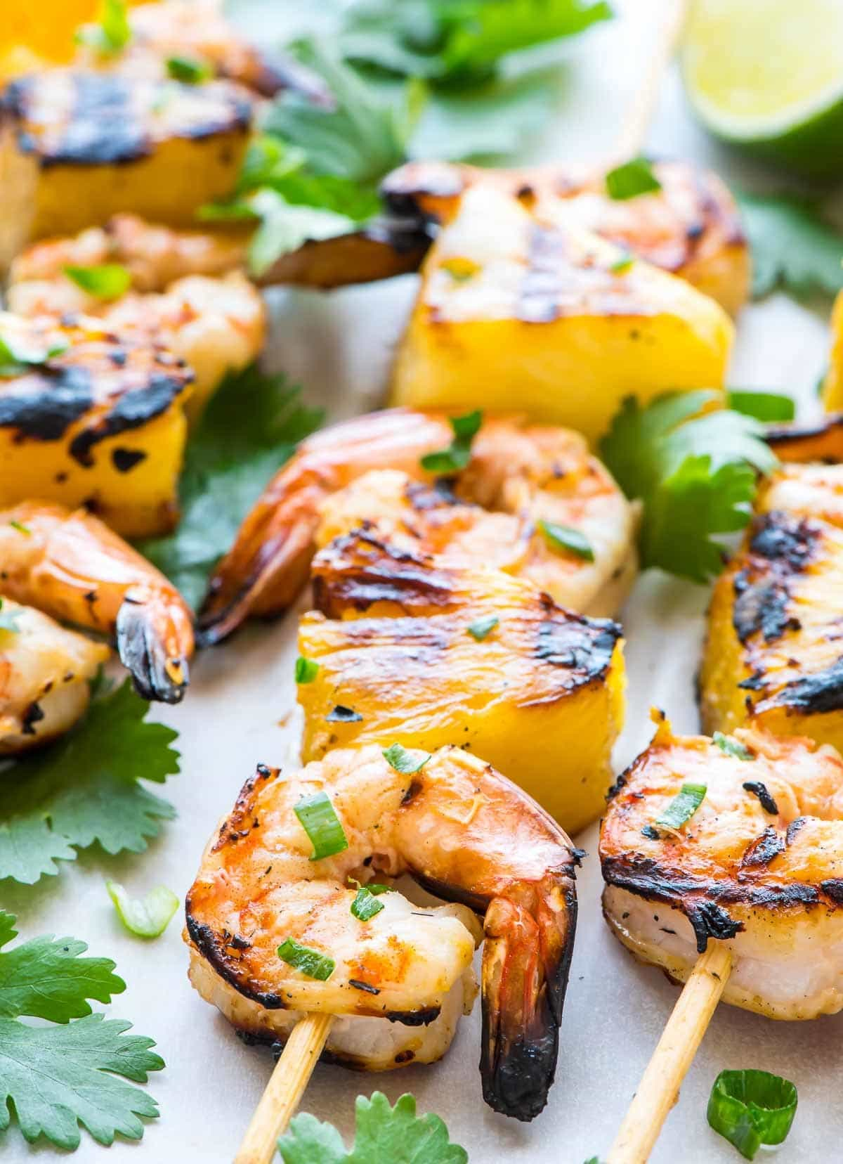 Coconut Pineapple Shrimp Skewers. The easiest, most flavorful way to cook shrimp! Juicy grilled shrimp kabobs with an irresistible citrus coconut marinade. Perfect for parties or a light summer meal. @wellplated