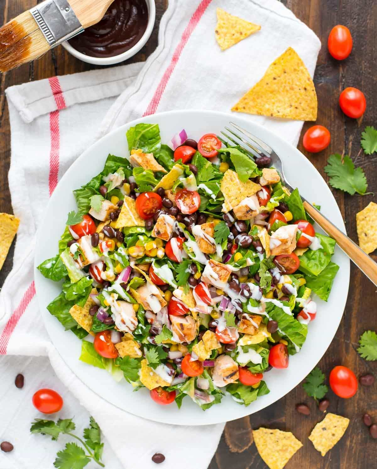 Copycat Panera BBQ Chicken Salad recipe — This easy, healthy salad comes together so quickly and is a family favorite! With creamy ranch, crunchy tortilla chips, and lots of fresh veggies. The perfect summer meal. @wellplated