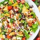 BBQ Chicken Salad recipe with creamy ranch dressing — Filling and flavorful! This healthy salad comes together quickly and is perfect for a summer meal. With juicy BBQ grilled chicken, crunchy tortilla chips, and lots of fresh veggies. @wellplated