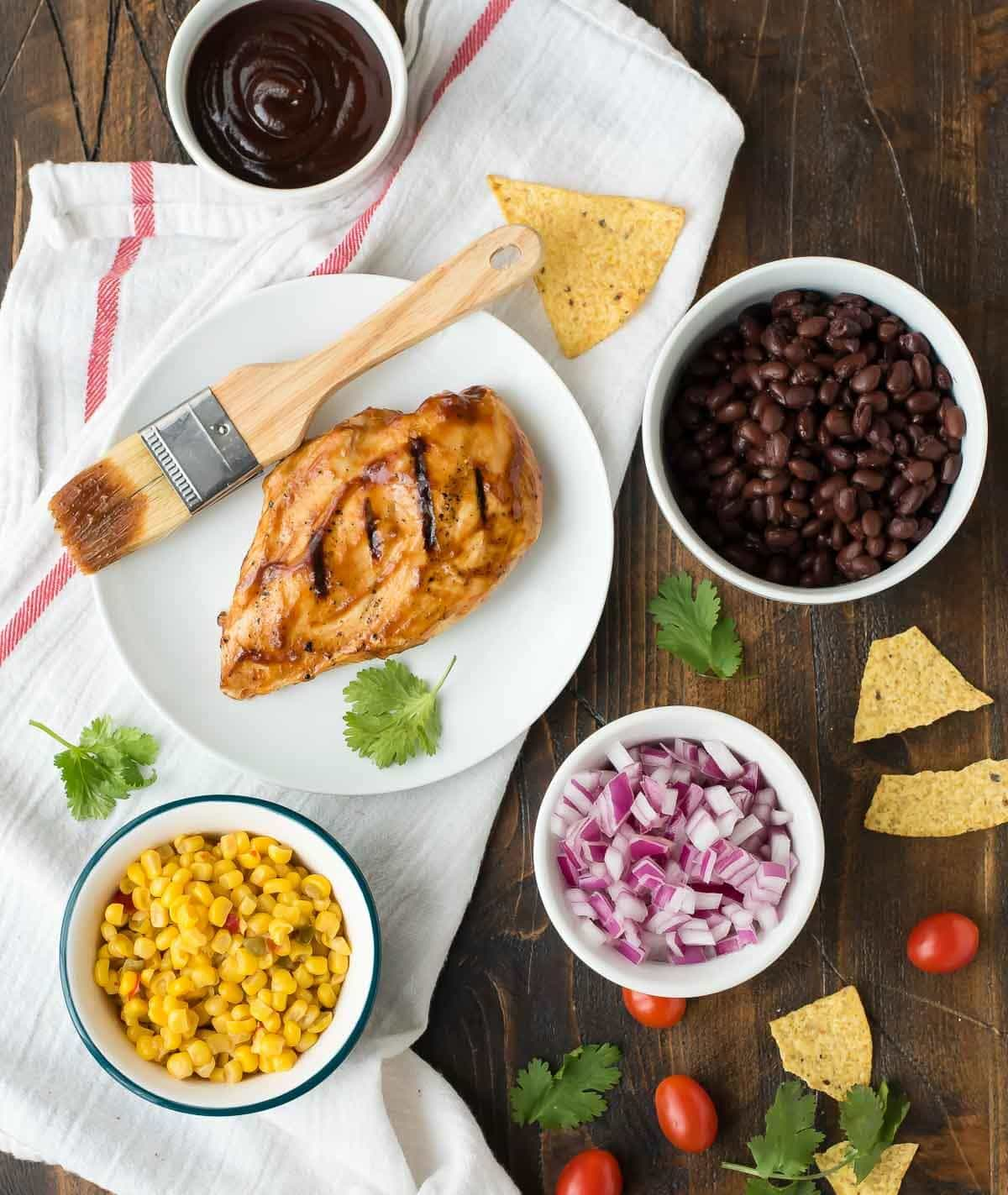 Copycat Panera BBQ Chicken Salad recipe — A healthy salad that comes together quickly, is filling, and tastes even better than the Panera original! Loaded with fresh veggies, juicy chicken, creamy ranch, and crunchy tortilla chips. @wellplated