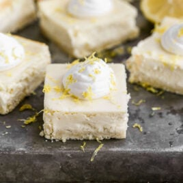 Strawberry Lemon Cream Cheese Bars — Buttery shortbread crust topped with a bright and creamy lemon cheesecake and layer of strawberry jam.