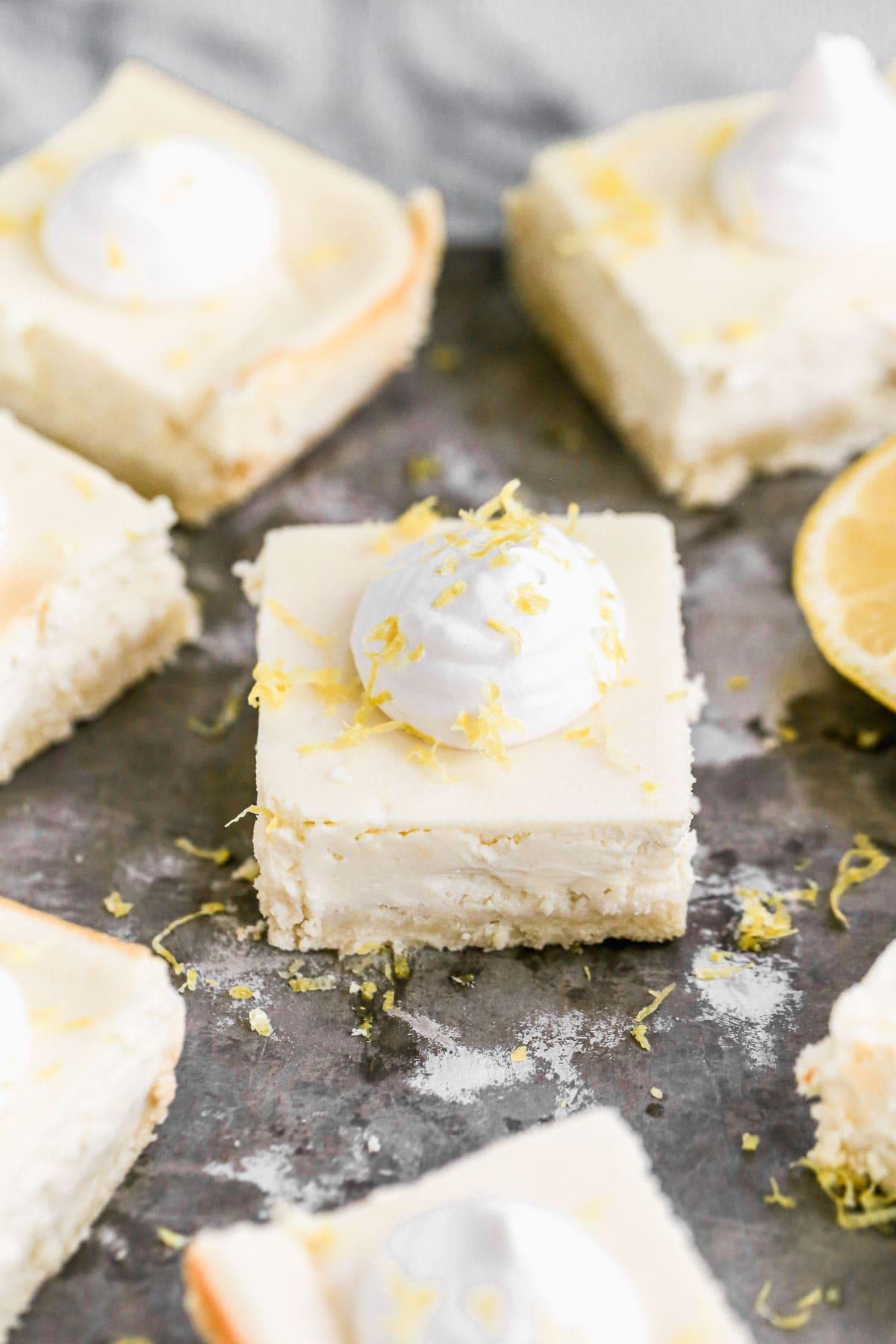 Simple and delicious Strawberry Lemon Cream Cheese Bars cut into squares on a white quartz countertop