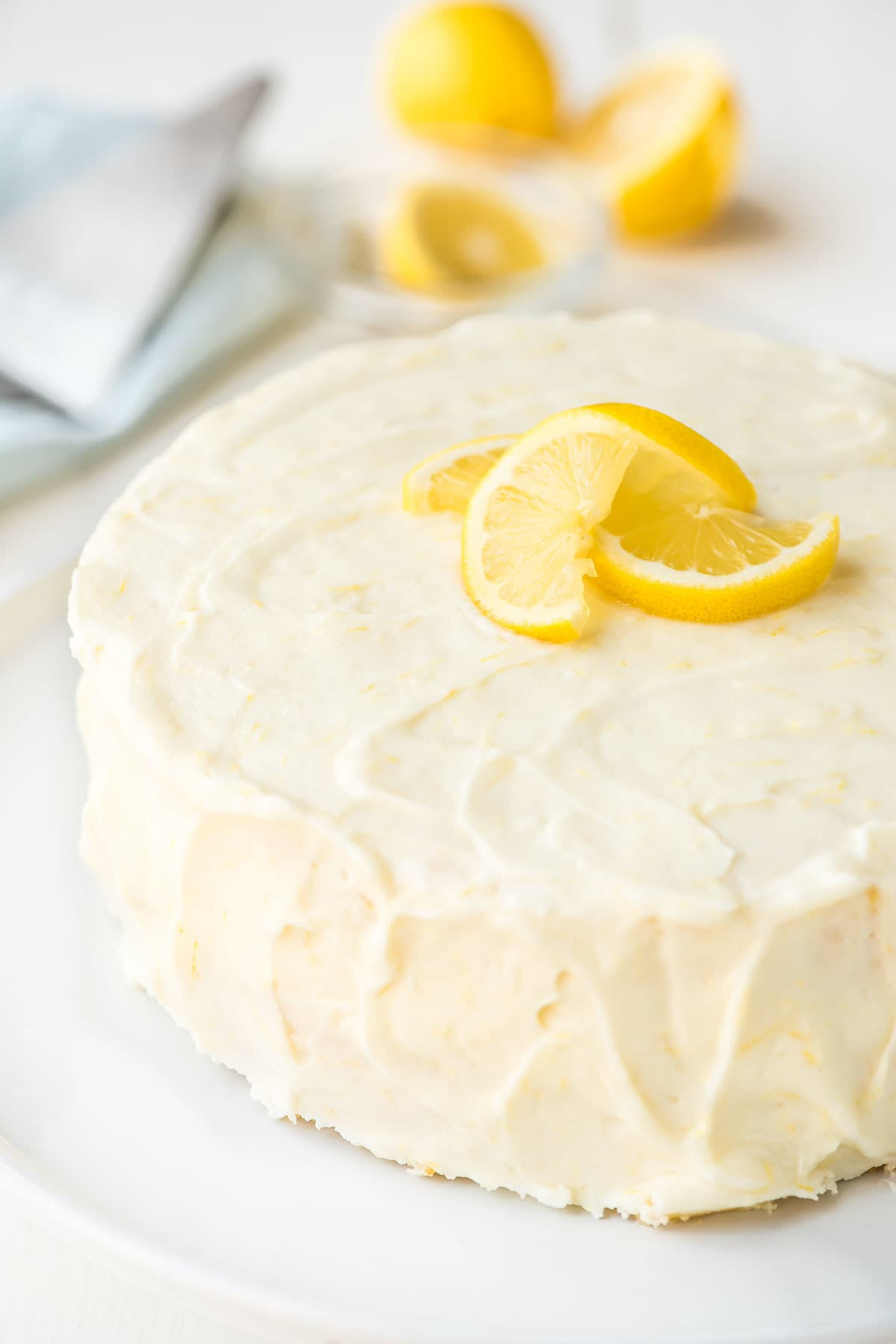 beautifully frosted lemon layer cake with lemon cream cheese frosting