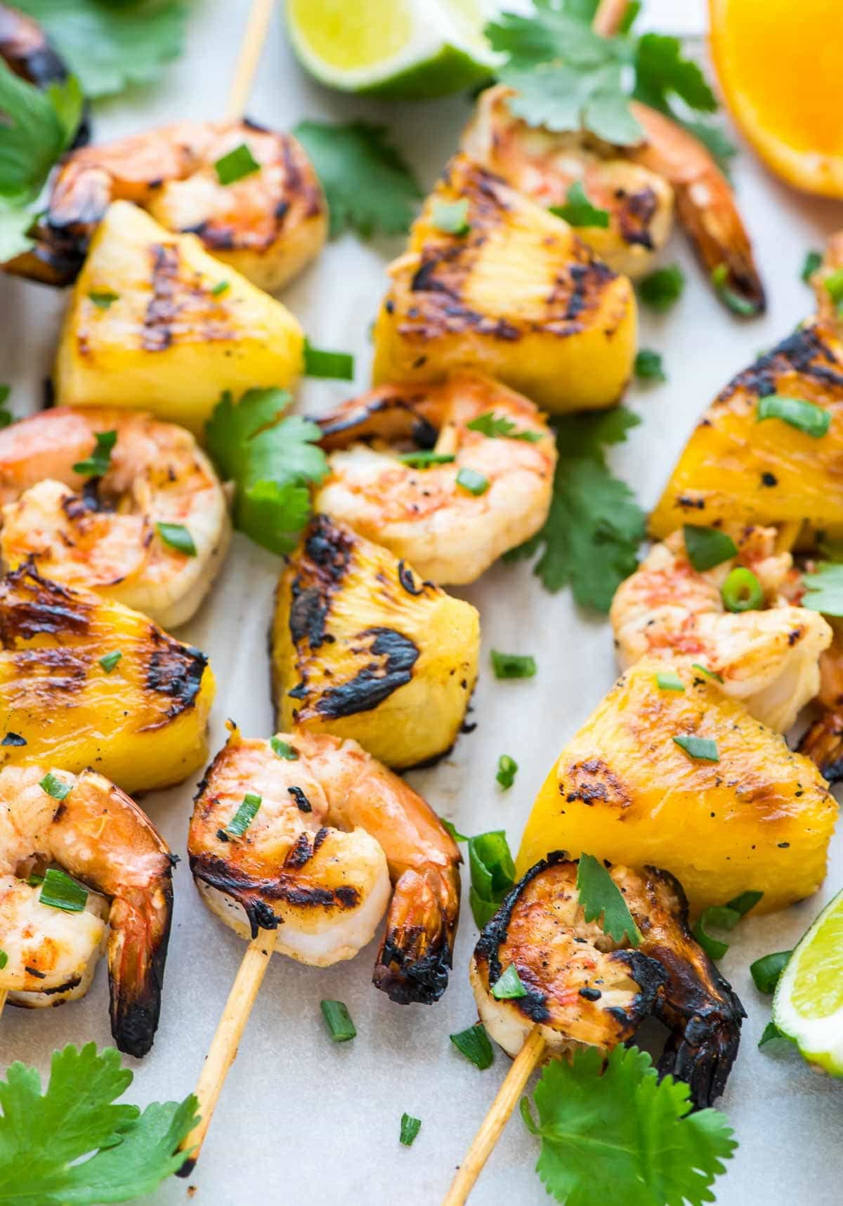 These Coconut Pineapple Shrimp Skewers are the easiest, most flavorful way to cook shrimp! The citrus coconut marinade is AMAZING and the shrimp are so juicy. Perfect for summer grilling and entertaining. @wellplated