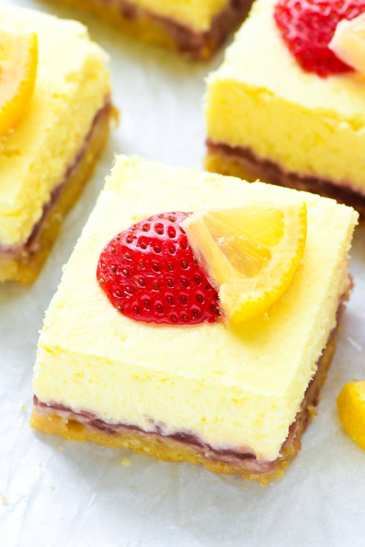 Creamy and rich Strawberry Lemon Cream Cheese Bars — Layers of buttery shortbread crust, strawberry jam, and creamiest lemon cheesecake. The perfect summer dessert for any picnic or potluck! @wellplated