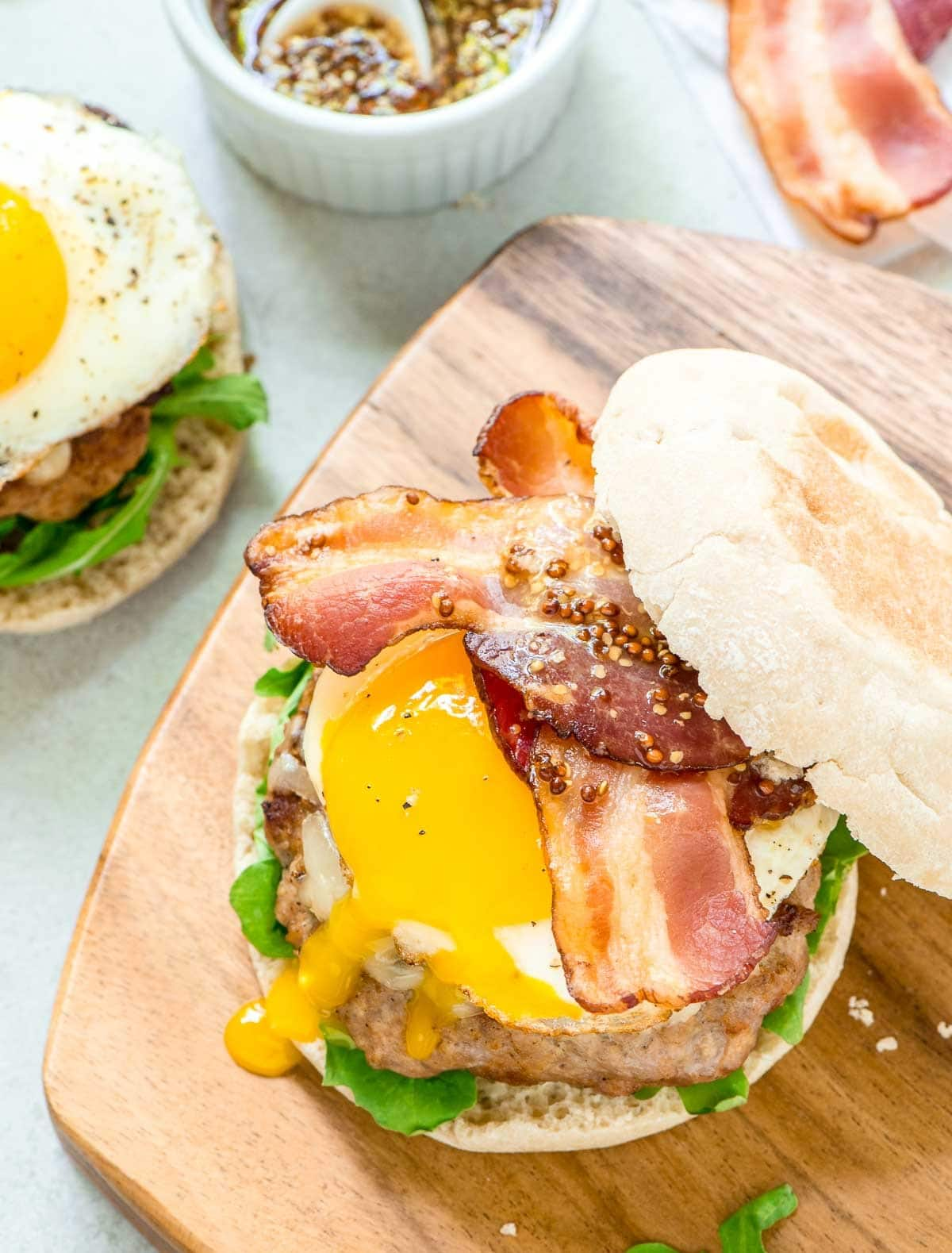 Maple Bacon Turkey Burgers — juicy turkey patty with a sweet, smoky maple flavor, crispy bacon, gooey cheese, and a fried egg. Perfect for summer grilling or even as a breakfast burger! @wellplated