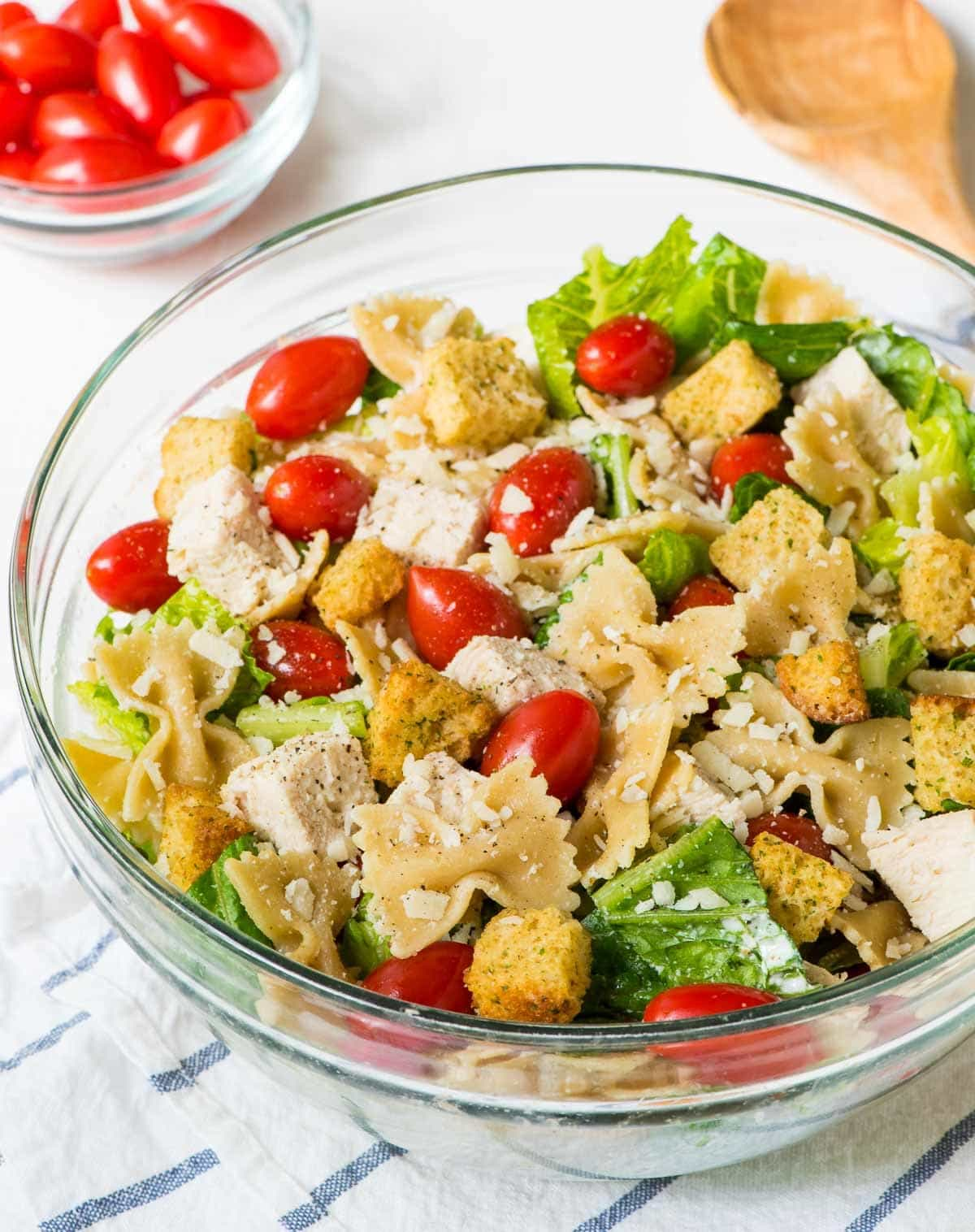 Bowtie Chicken Caesar Pasta Salad — EASY recipe that's a great side dish or hearty enough for an all-in-one meal. Whole wheat pasta, crisp veggies, and the best creamy homemade Caesar dressing. @wellplated