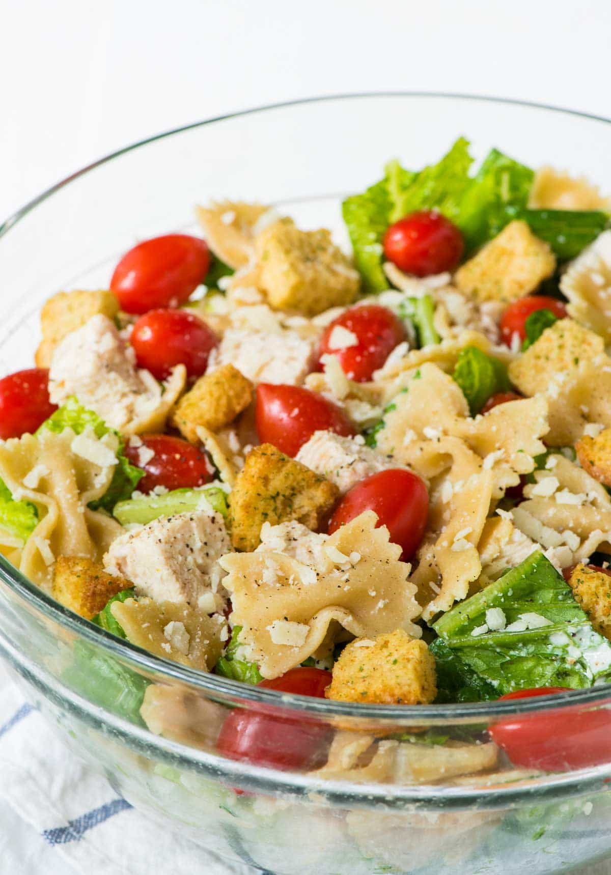 Bowtie Chicken Caesar Pasta Salad recipe made with fresh, healthy ingredients. Creamy, EASY and a hit everywhere I bring it! @wellplated