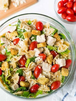 Chicken Caesar Pasta Salad — EASY recipe and a hit everywhere I bring it! Healthy version made with fresh ingredients and the best homemade Caesar dressing. @wellplated