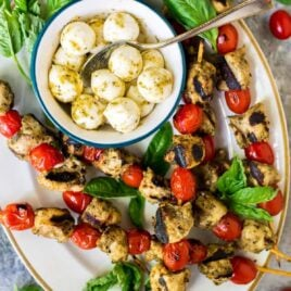These Grilled Pesto Chicken Kebabs are the perfect summer dish! EASY recipe with ONLY THREE INGREDIENTS — Serve as appetizer at your next backyard bash, or have them for dinner any night of the week. Healthy and delicious! @wellplated