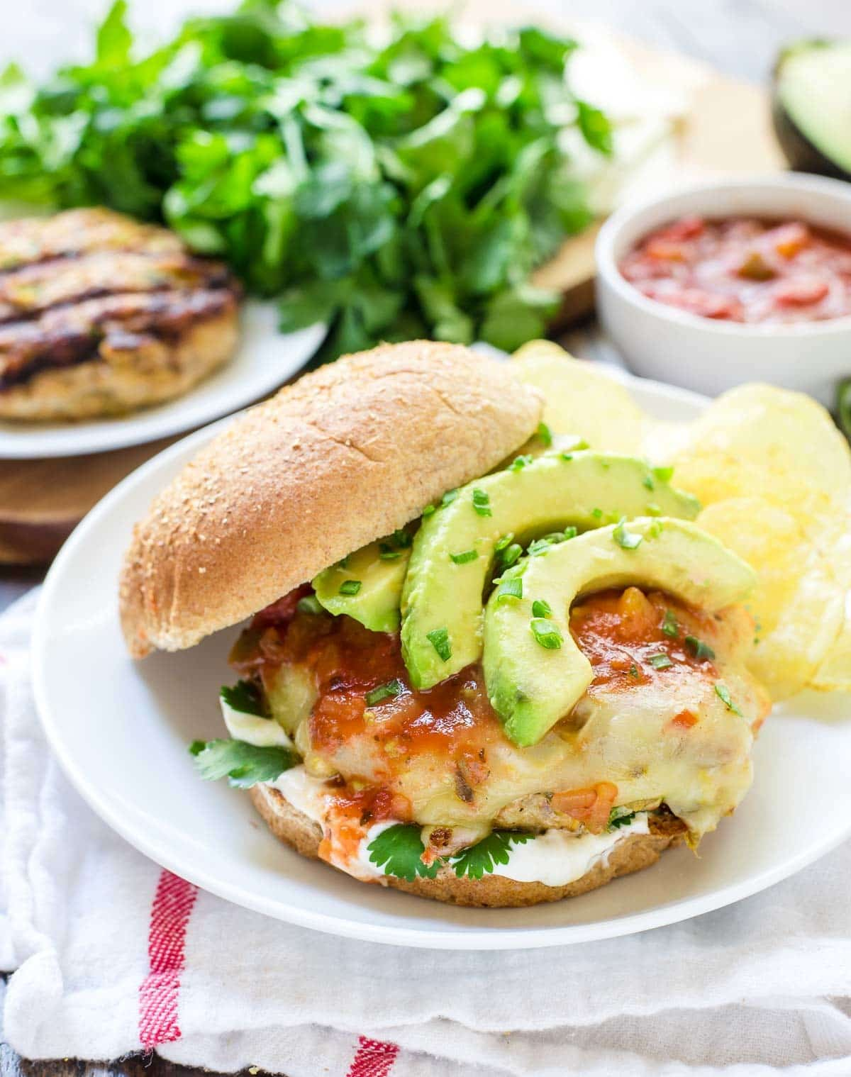 This juicy Green Chile Grilled Chicken Burger recipe is my go-to for healthy summer meals. The patties are SO MOIST. Easy, and our whole family loves it!