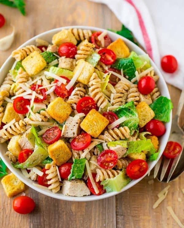 Healthy Chicken Caesar Pasta Salad. DELISH! Fresh, creamy, and packed with fresh veggies and juicy chicken. The dressing is made with Greek yogurt, so it's super creamy but much lighter. Perfect for parties, healthy lunches and dinners, and busy families. Use bowtie pasta or any shape you love.