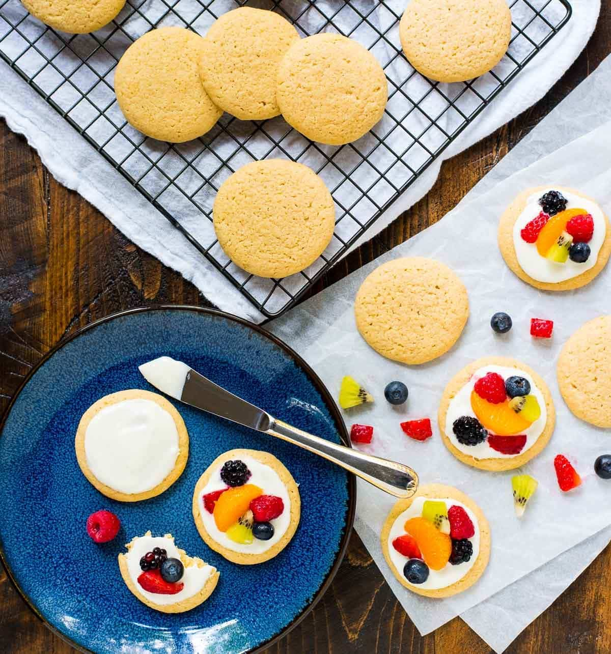 Mini Fruit Pizza Cookies — Buttery lemon cookies topped with sweet cream cheese frosting and bright fresh fruit. Fun to make and absolutely heavenly! @wellplated