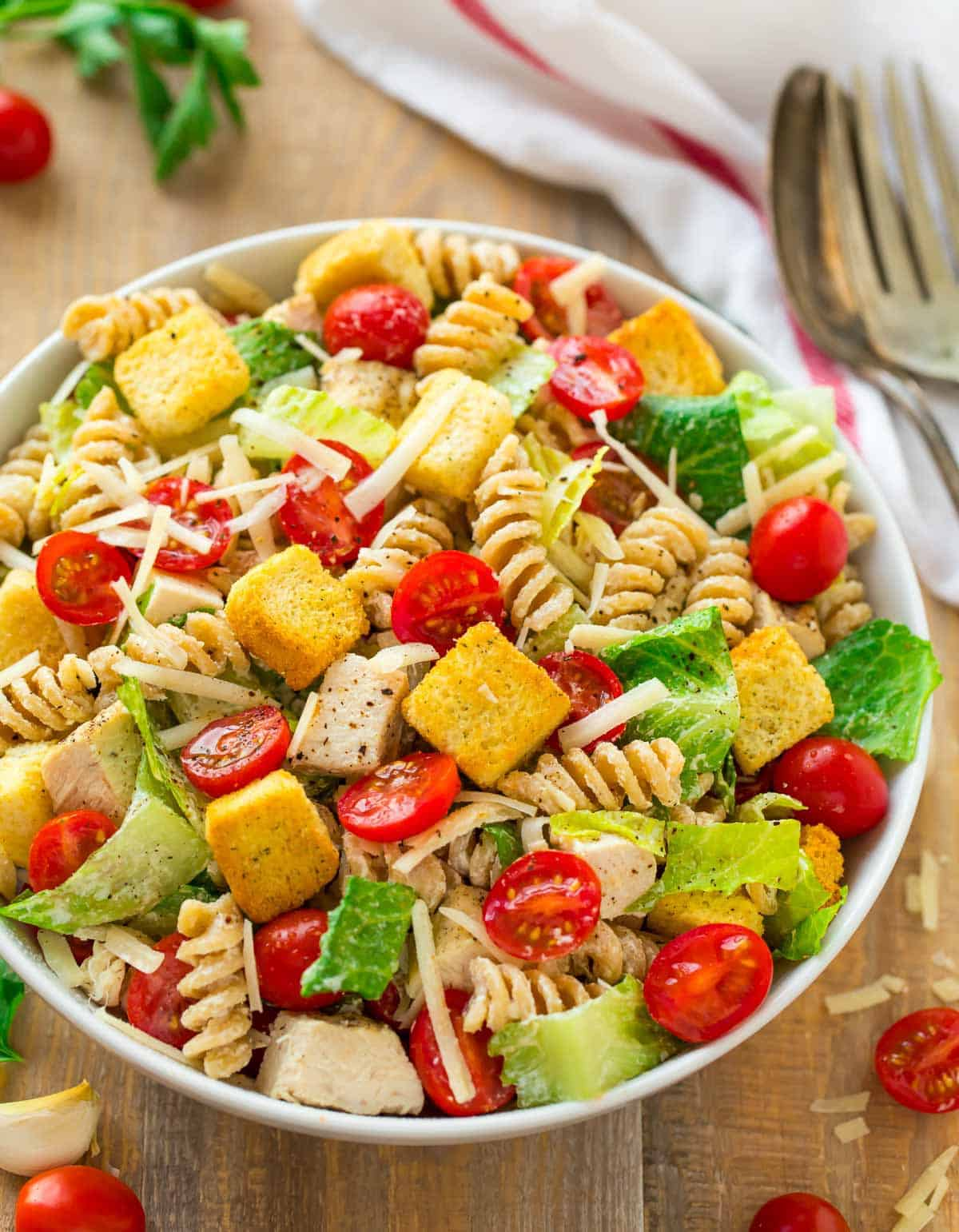 Healthy Chicken Caesar Pasta Salad made with whole wheat pasta in a serving bowl.