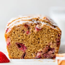 This ultra moist Strawberry Bread is made in just one bowl and tastes INCREDIBLE! Made with Greek yogurt, loads of juicy strawberries, and topped with a sweet vanilla glaze. Easy and healthy! @wellplated