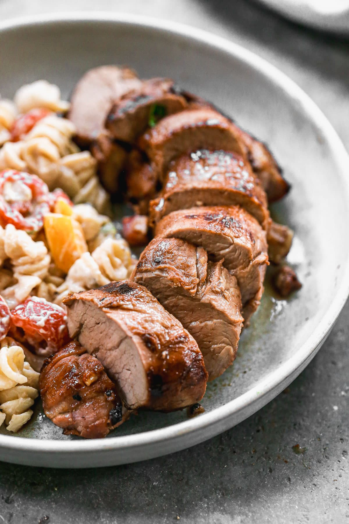 Grilled Mustard Pork Tenderloin with Cheesy Foil Packet Veggies. The easiest way to cook vegetables and meat on the grill! Juicy, tender, and perfectly cooked every time, no clean up required! @wellplated