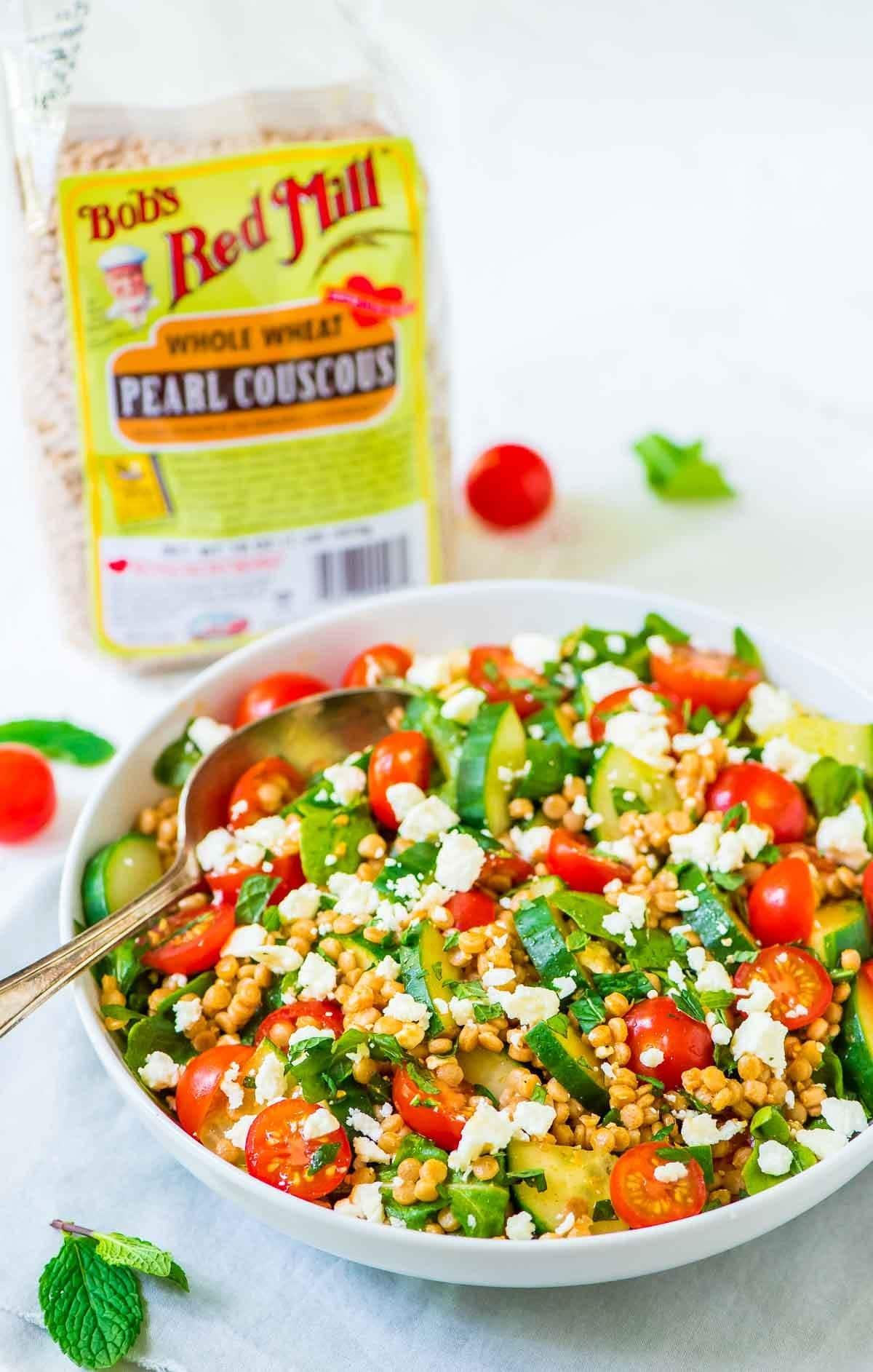 Tomato, Cucumber, and Feta Couscous Salad recipe — healthy and flavor PACKED! A quick and easy meal that's perfect for summer. @wellplated