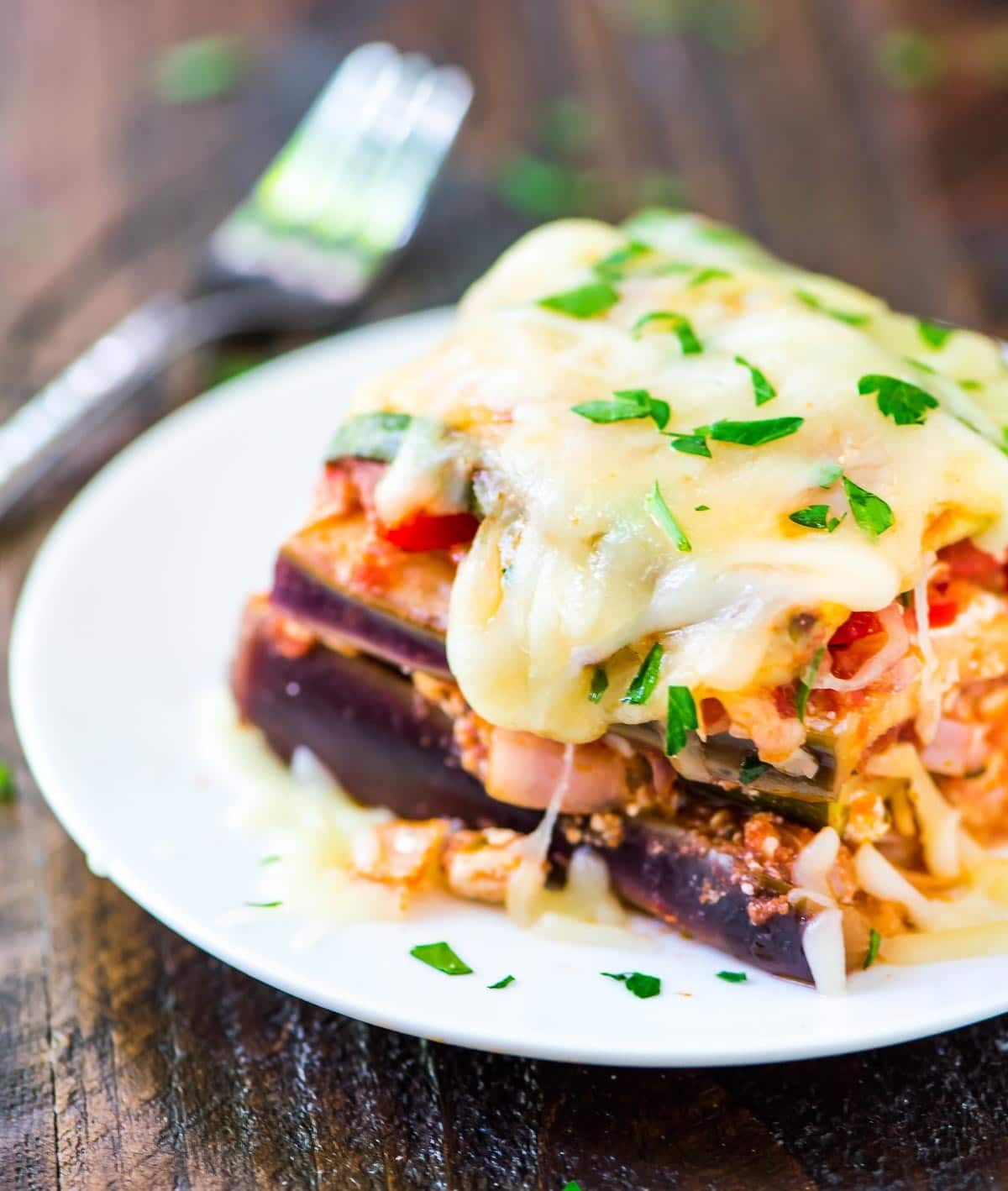 Easy Crock Pot Vegetarian Lasagna. The BEST way to get your veggies and our whole family loved it! No noodles — just zucchini, eggplant, and cheesy goodness — Low carb, high protein, and you'll never miss the pasta! @wellplated