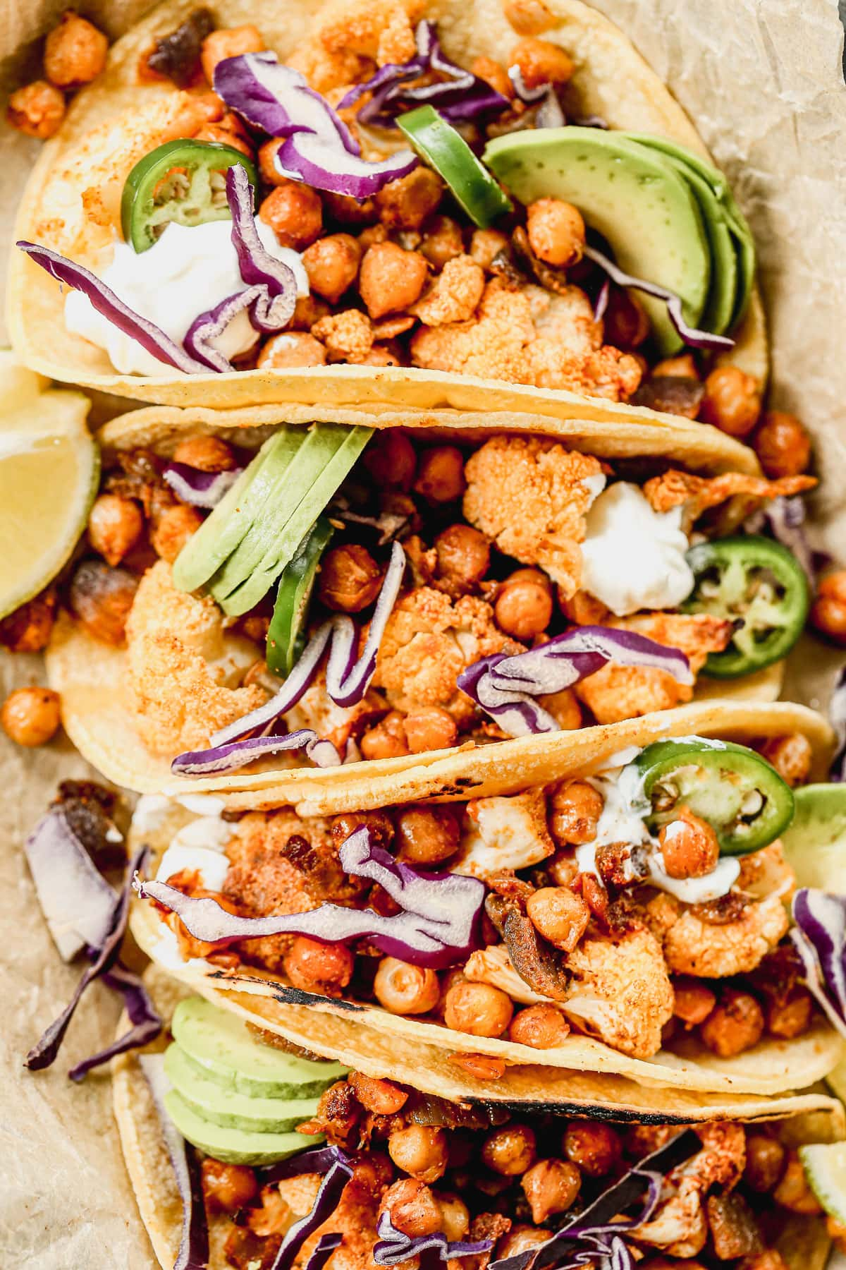 Crispy Chickpea Cauliflower Tacos: Spicy roasted cauliflower and chickpeas make the most delicious, low-fat vegan taco filling ever! {low carb, gluten free} @wellplated