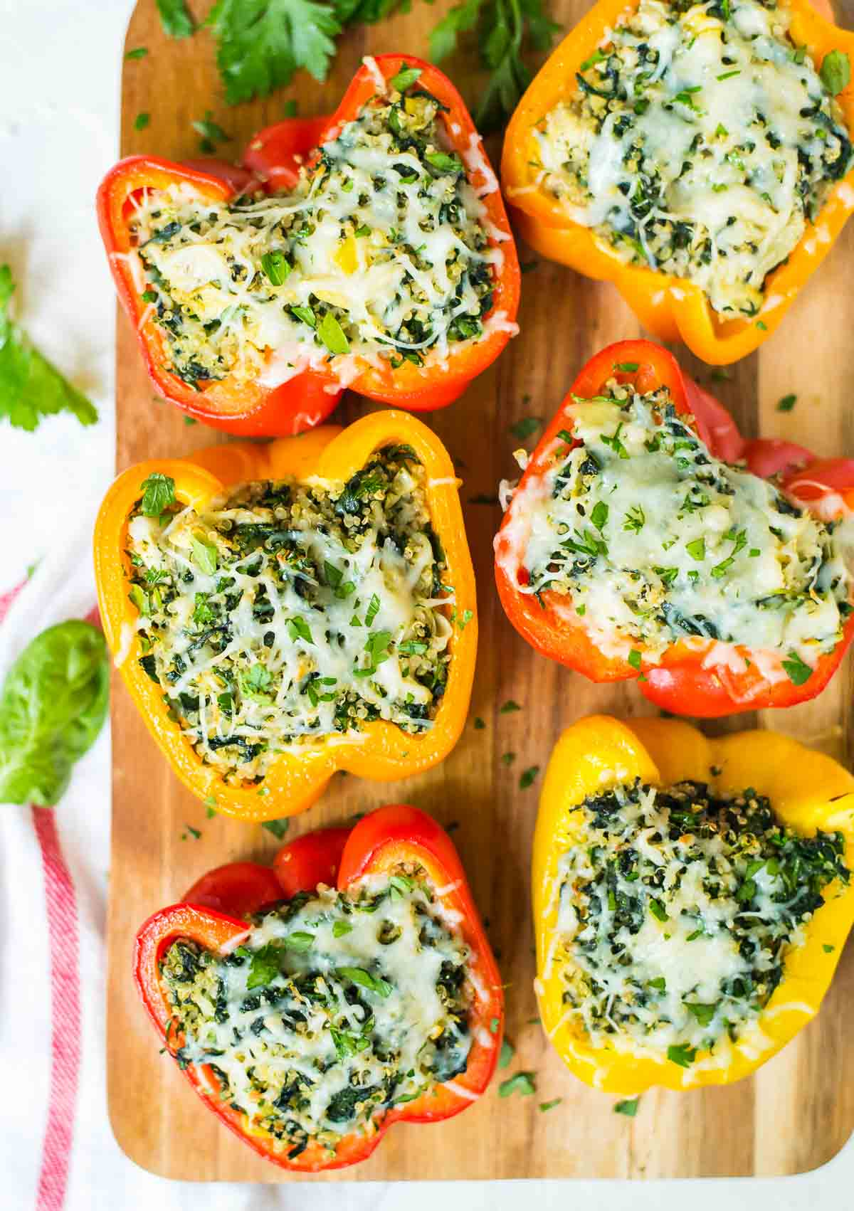 Cheesy Spinach Artichoke Quinoa Stuffed Bell Peppers – Everyone's favorite dip, turned into a quick and healthy meal! @wellplated
