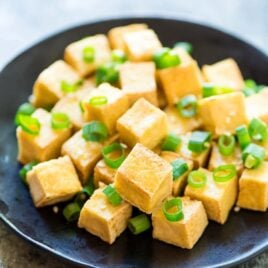 CRISPY Tofu the EASY way! No baking, pressing, or deep frying required. Use this trick to cook tofu that comes out perfectly every time, and is perfect for all of your favorite stir fries, sauces, and even salads! @wellplated