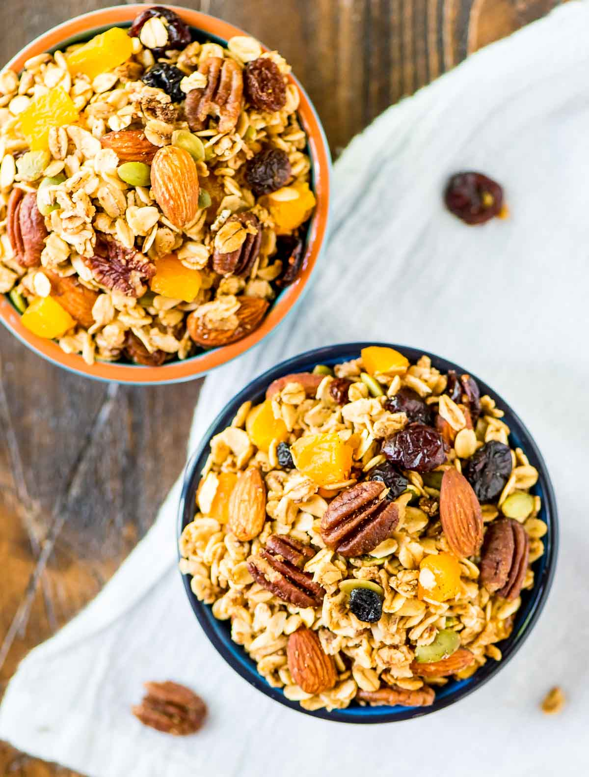 This Crock Pot Granola recipe is the BEST, easiest homemade granola ever! Healthy recipe made with simple ingredients like oatmeal, nuts, and naturally sweetened with maple syrup. {vegan, gluten free, dairy free, clean eating} @wellplated