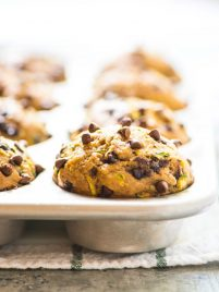 muffin pan full of Chocolate Chip Banana Healthy Zucchini Muffins