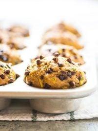 muffin pan full of Chocolate Chip Banana Healthy Zucchini Muffins