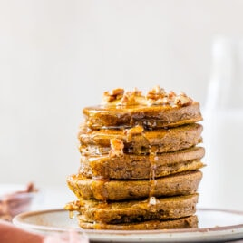 A stack of healthy pumpkin pancakes with butter and sryup