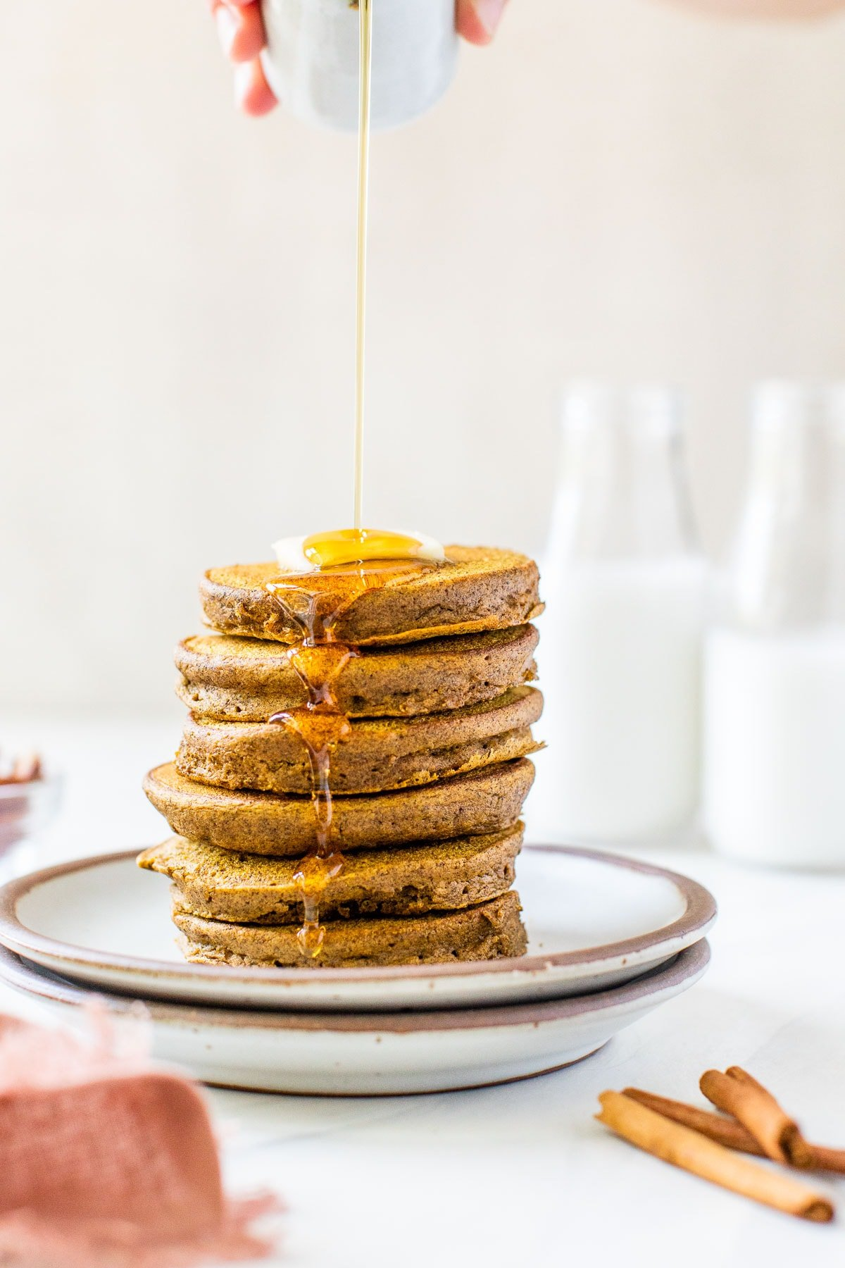 FLUFFY Healthy Pumpkin Pancakes, made EASY in the blender with buckwheat flour and loads of spices! Gluten free, kid-friendly, and no clean up. @wellplated