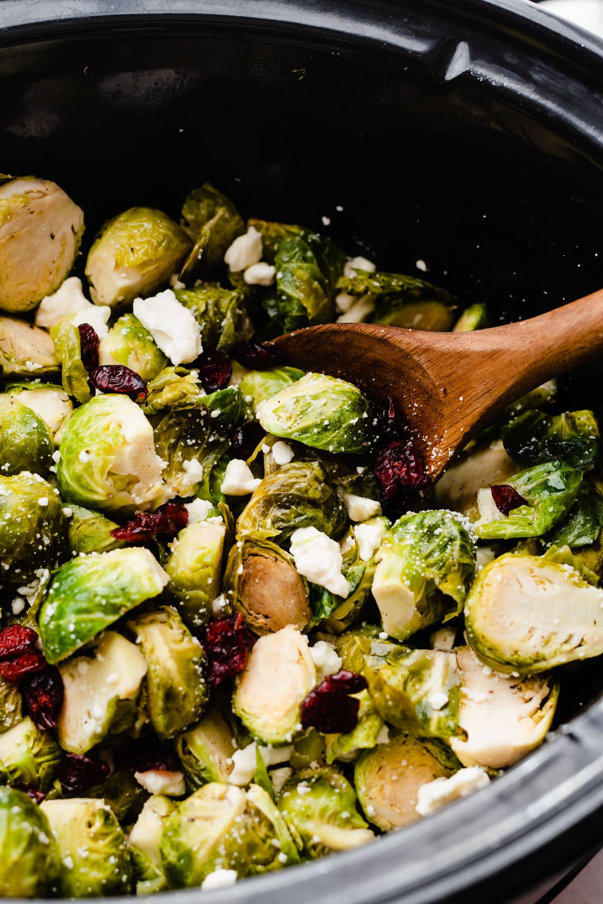 Slow Cooker Brussels Sprouts with Cranberries and Feta. Free up your oven! Easy crockpot recipe that's perfect for holiday parties, Thanksgiving, Christmas, or anytime you need an easy side. @wellplated