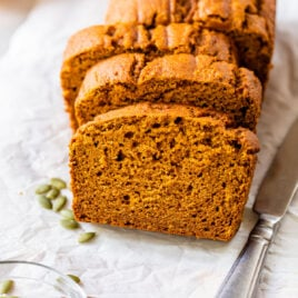 slices of low fat pumpkin bread on a piece of white parchment baking paper