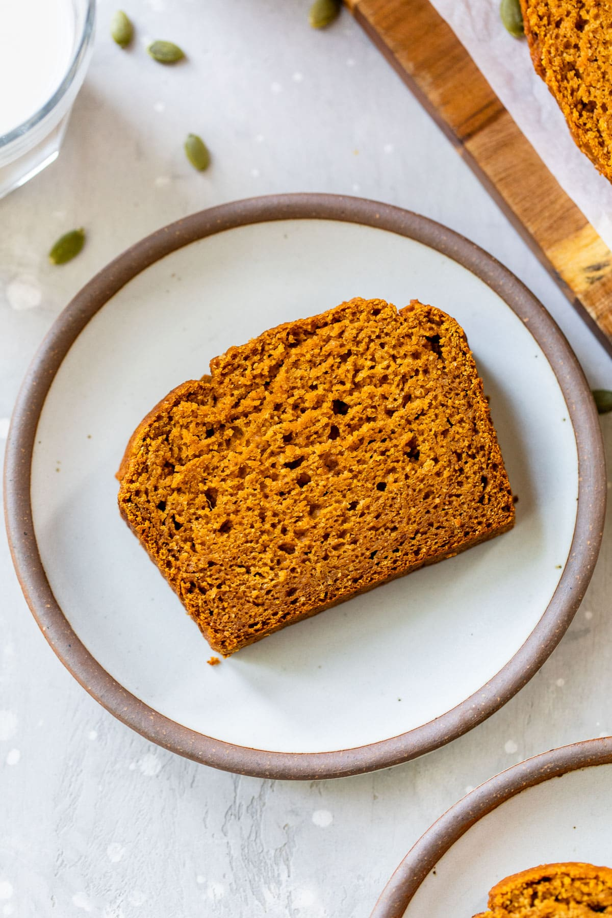 A loaf of orange bread with millet