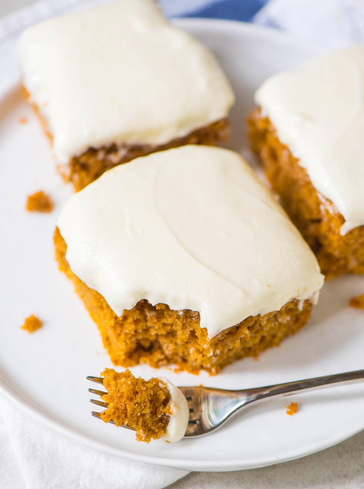 Greek Yogurt Pumpkin Spice Sheet Cake with Cream Cheese Frosting. SO DELICIOUS. Healthy pumpkin dessert recipe that's just as moist and decadent as the original. EASY, one-bowl, and perfect for fall and Thanksgiving or holiday dessert tables. @wellplated