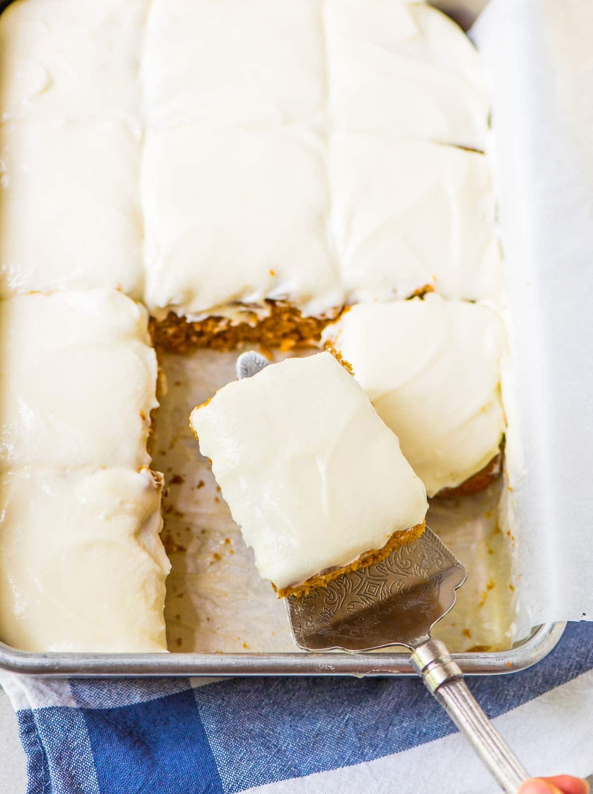 Classic Pumpkin Sheet Cake with Cream Cheese Frosting. MOIST recipe and so easy to make! One bowl, healthy recipe made with Greek yogurt. @wellplated