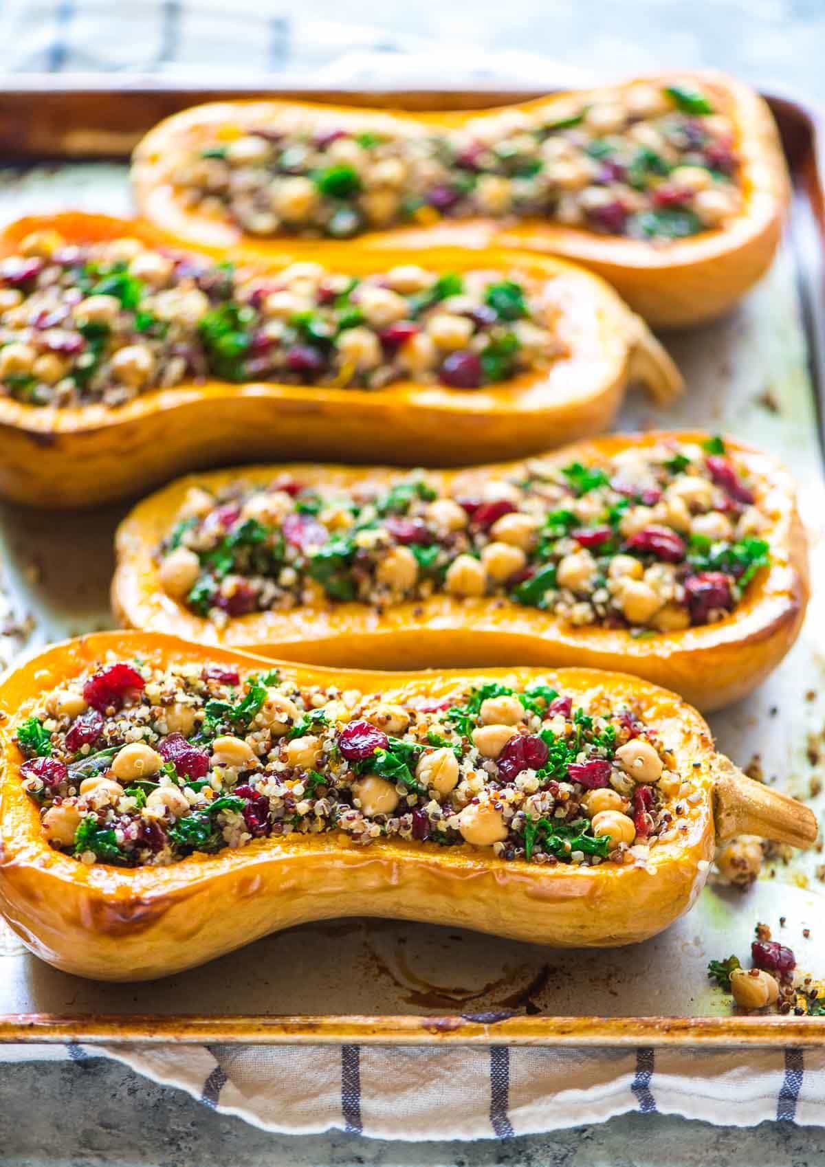 Quinoa Stuffed Butternut Squash with Cranberries and Kale. An easy, healthy vegetarian meal that everyone will love! #fall | wellplated.com @wellplated