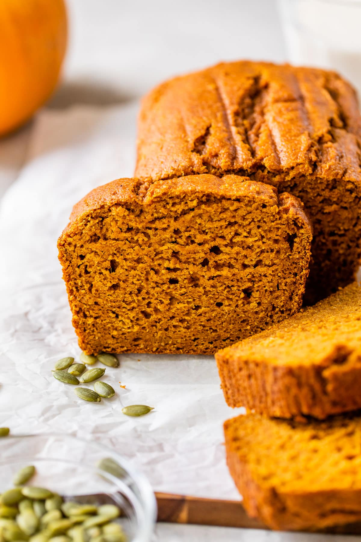 Healthy pumpkin bread is soft, moist, and delicious! Made with honey, Greek yogurt, whole wheat flour, and millet, this easy one-bowl pumpkin bread recipe will be your new favorite! #healthy #recipe #pumpkin