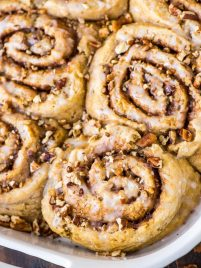 Biscuit Cinnamon Rolls from scratch – So much easier than classic cinnamon rolls, and they taste even better! NO YEAST, NO RISING. Buttermilk biscuit dough filled with gooey cinnamon sugar, topped with the best frosting. Fluffy, soft, and so delicious! Recipe at wellplated.com | @wellplated