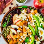 Harvest Cobb Salad. A fall twist on classic Cobb salad with butternut squash, bacon, apples, and goat cheese. Chicken and avocado make it healthy and filling. Perfect as a main dish salad or for Thanksgiving, Christmas, or anytime you need a great holiday side dish. Recipe at wellplated.com | @wellplated