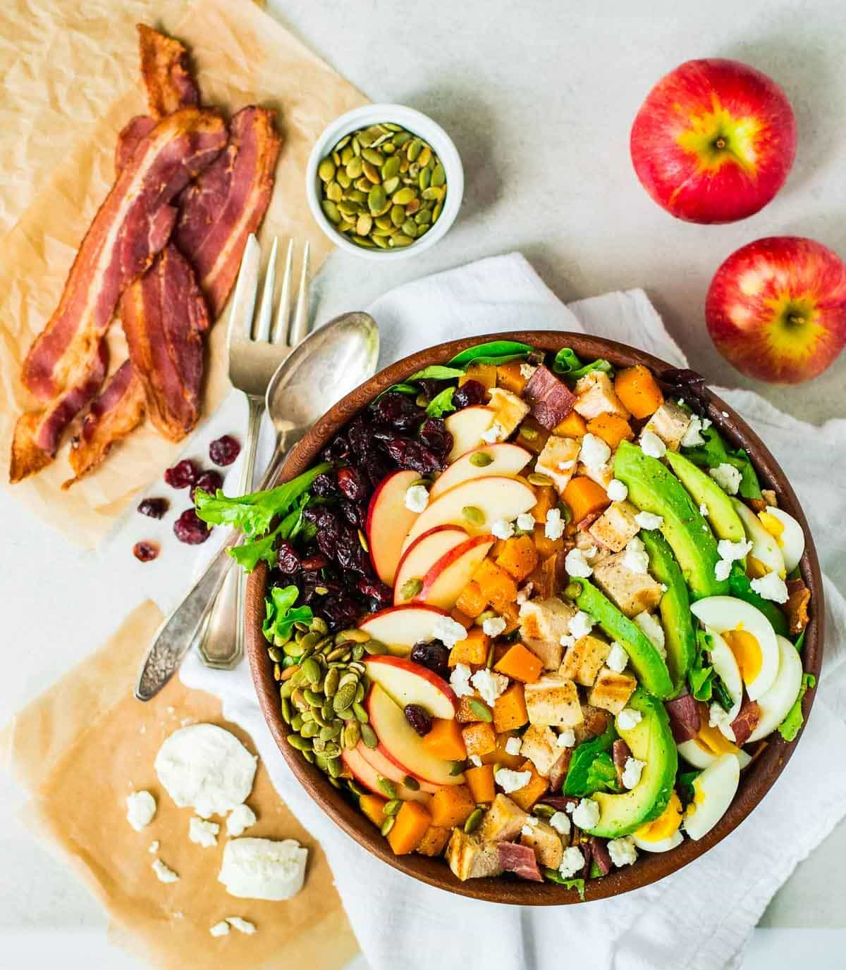 A fall twist on classic Cobb salad that everyone will love! Butternut squash, bacon, apples, goat cheese, and avocado. Filling and delicious. Perfect for Thanksgiving, Christmas, or any holiday, or as a main dish salad. Recipe at wellplated.com | @wellplated