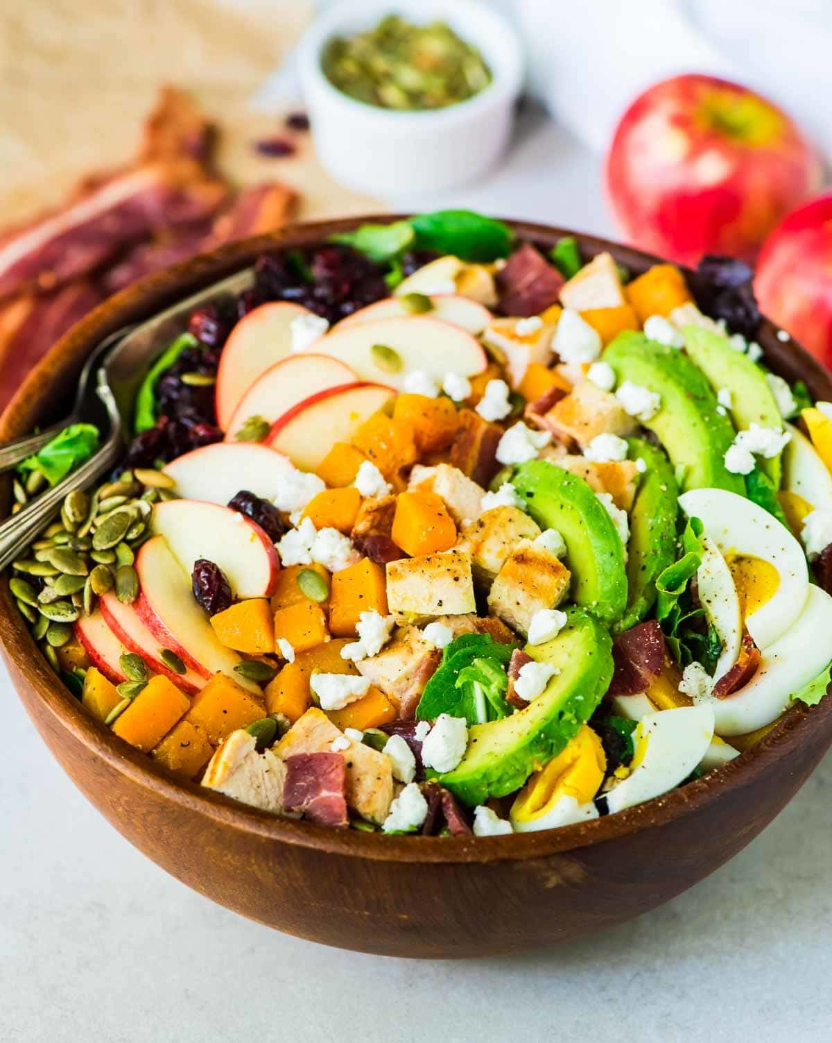 Harvest Cobb Salad with Butternut Squash, Chicken, Apples, Cranberries, and Goat Cheese. Healthy recipe that's perfect for a main dish salad. Easy to make ahead for a Thanksgiving side dish, or any holiday gathering. Recipe at wellplated.com | @wellplated