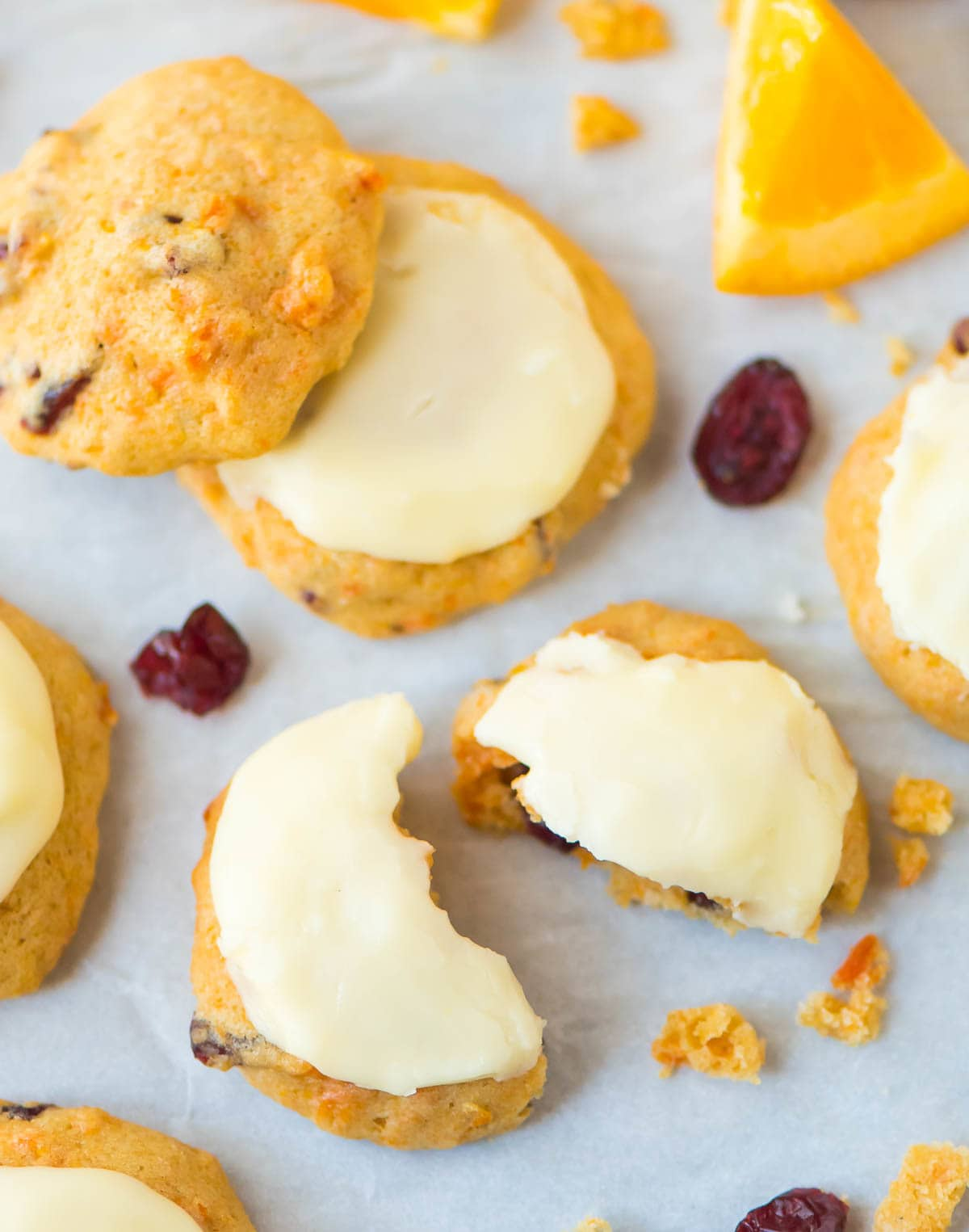 Melt in Your Mouth Cranberry Orange Cookies. Soft, citrusy, and frosted with creamy orange icing. Easy drop cookies you are going to love! Recipe at wellplated.com   @wellplated