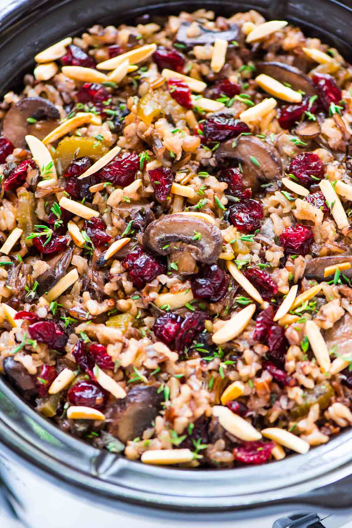 Free up the oven for Thanksgiving with this Crockpot Stuffing with Wild Rice and Cranberries. An easy, DELICIOUS gluten free stuffing recipe that everyone can enjoy! Simple, cozy slow cooker recipe that's perfect for holidays or anytime you are hosting a crowd. Recipe at wellplated.com   @wellplated {vegan, gluten free}
