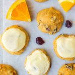Frosted Orange Cookies with Cranberries. MELT IN YOUR MOUTH. Super soft and easy to make! Perfect for Christmas or anytime you want to bake. Recipe at wellplated.com | @wellplated
