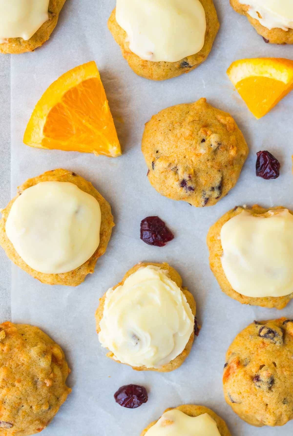 Frosted Orange Cookies with Cranberries. MELT IN YOUR MOUTH. Super soft and easy to make! Perfect for Christmas or anytime you want to bake. Recipe at wellplated.com   @wellplated